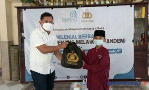 Penggerak Milenial Indonesia Dan Polri Bagikan Ratusan Paket Sembako